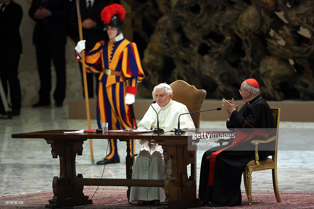Pope Benedict XVI, sits beside cardinal Agostino Vallini (R), as he attends a meeting with parish priests of Rome's diocese at the Paul VI Hall on February 14, 2013 in Vatican City, Vatican. The Pontiff will hold his last weekly public audience on February 27 at St Peter's Square after announcing his resignation earlier this week.