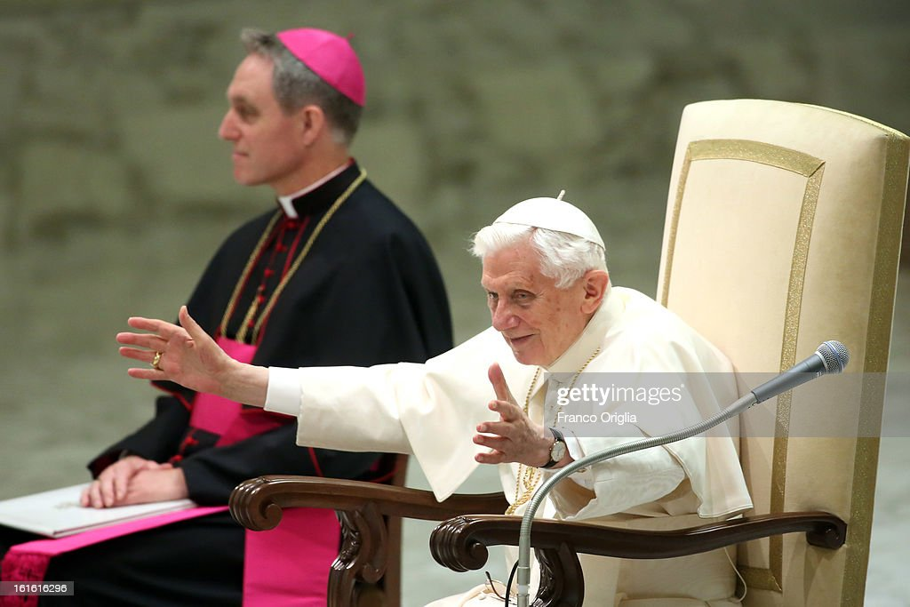 Pope Benedict XVI sits beside his personal secretary Georg Ganswein (L) as he waves to the faithful during his weekly audience on February 13, 2013 in Vatican City, Vatican. The Pontiff will hold his last weekly public audience on February 27 at St Peter's Square after announcing his resignation earlier this week.
