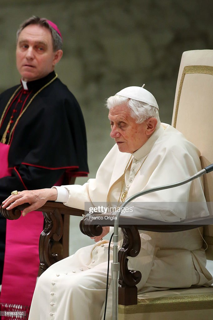 Pope Benedict XVI sits beside his personal secretary Georg Ganswein during his weekly audience on February 13, 2013 in Vatican City, Vatican. The Pontiff will hold his last weekly public audience on February 27 at St Peter's Square after announcing his resignation earlier this week.