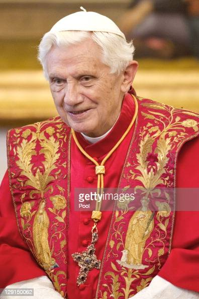 Pope Benedict XVI sits while meeting with Honduran President Porfirio Lobo Sosa at the Pope's private library on October 13 2011 in Vatican City the...
