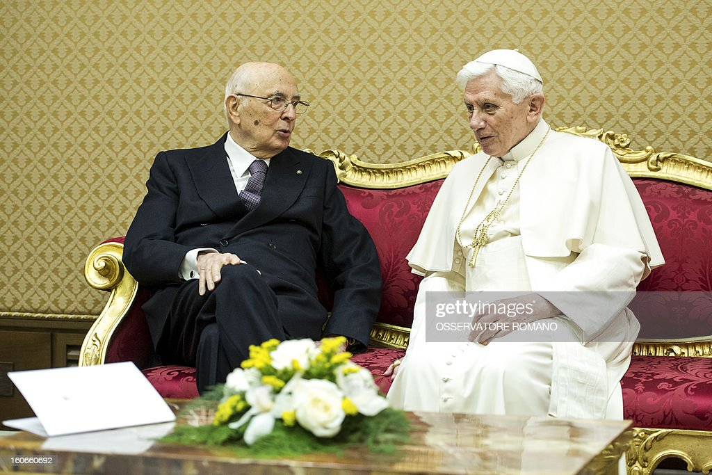 CREDIT 'AFP PHOTO / OSSERVATORE ROMANO' - NO MARKETING NO ADVERTISING CAMPAIGNS - DISTRIBUTED AS A SERVICE TO CLIENTS Pope Benedict XVI (R) speaks with Italy's president Giorgio Napolitano in a private room before the concert by the Orchestra del Maggio Fiorentino, directed by Indian conductor Zubin Metha, to celebrate the 84th Lateran pact's anniversary on February 4, 2013, in the Vatican city.