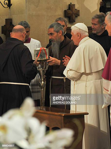 Pope Benedict XVI speaks with unindentified persons in front of a box allegedly containing the heart of Padre Pio in St Mary of Grace church in San...