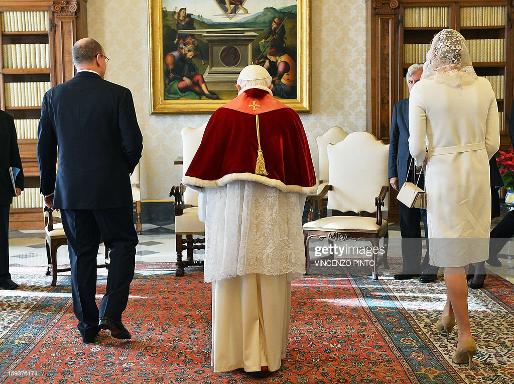 Pope Benedict XVI (C) talks to Prince Albert II of Monaco and his wife Princess Charlene on January 12, 2013 during a private audience at Vatican.