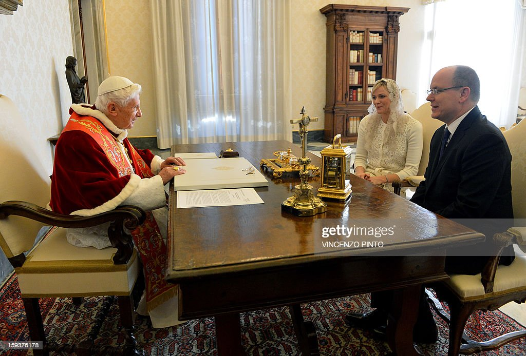 Pope Benedict XVI (L) talks to Prince Albert II of Monaco and his wife Princess Charlene on January 12, 2013 during a private audience at Vatican.