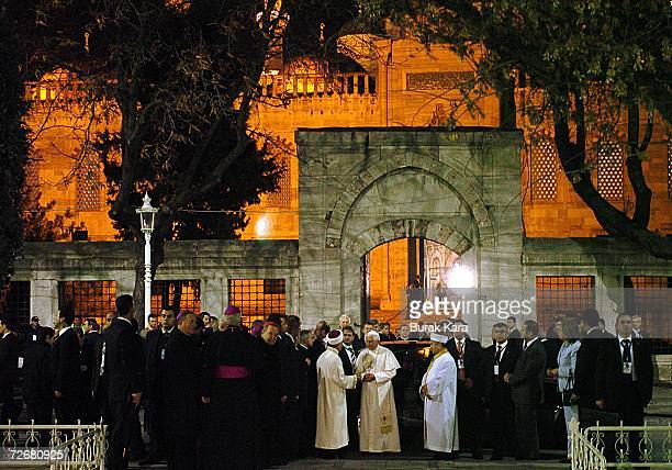 Pope Benedict XVI talks with Mustafa Cagrici Mufti of Istanbul as Emrullah Hatipoglu the imam of the Blue Mosque watches before his visit to one of...