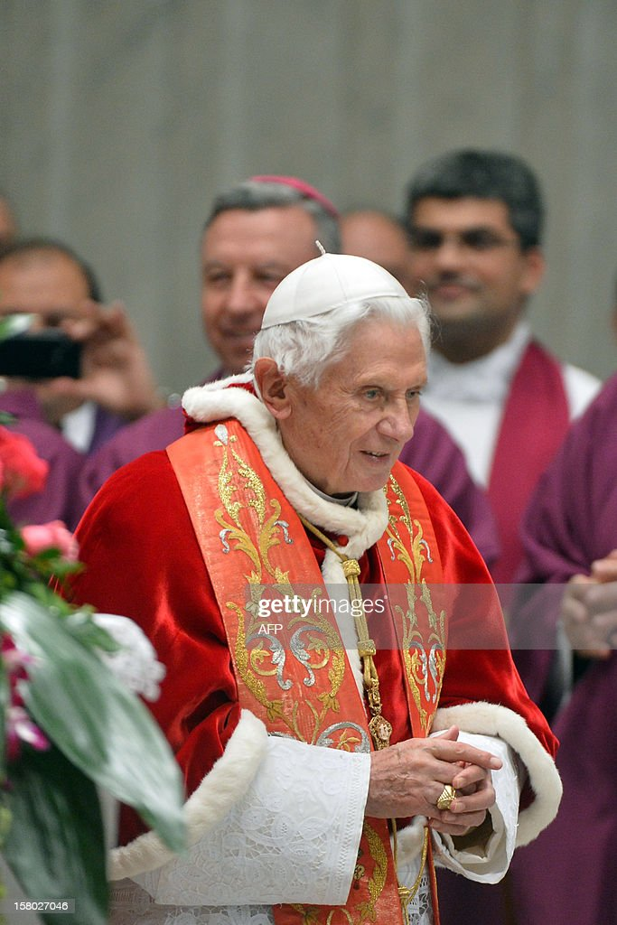 Pope Benedict XVI walks during the mass for the international congress 'Ecclesia in America' on December 9, 2012 at St Peter's basilica at the Vatican.