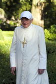 Pope Benedict XVI walks in the gardens of his summer residence on July 26 2010 in Castel Gandolfo near Rome Italy The Pontiff will visit England from...