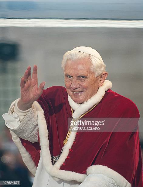 Pope Benedict XVI waves as he arrives for a prayer ceremony during the traditionnal visit to the statue of Mary on the day of the celebration of the...