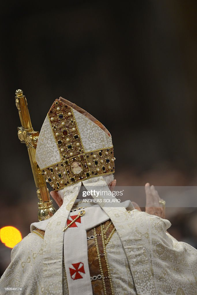 Pope Benedict XVI waves as he leaves after leading a Holy Mass for the Solemnity of the presentation of Our Lord on Febraury 2, 2013 at St Peter's basilica at the Vatican.