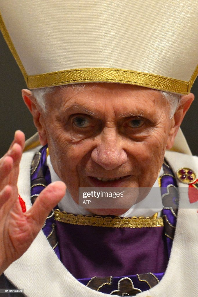 Pope Benedict XVI waves as he leaves the mass for Ash Wednesday, opening Lent, the forty-day period of abstinence and deprivation for the Christians, before the Holy Week and Easter, on February 13, 2013 at St Peter's basilica at the Vatican. Pope Benedict XVI made his first public appearance on Wednesday since his shock resignation announcement, asking thousands of cheering pilgrims at the Vatican to 'keep praying for me'. AFP PHOTO / GABRIEL BOUYS