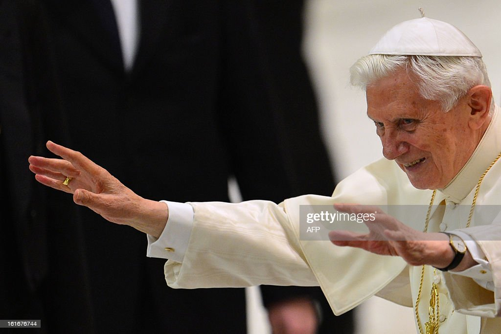 Pope Benedict XVI waves during an audience with Rome's parish priests on February 14, 2013 at the Paul VI hall at the Vatican. Pope Benedict XVI addresses on Thursday Rome's parish priests, talking about his personal experiences as a young church reformer ahead of his stepping down at the end of the month.