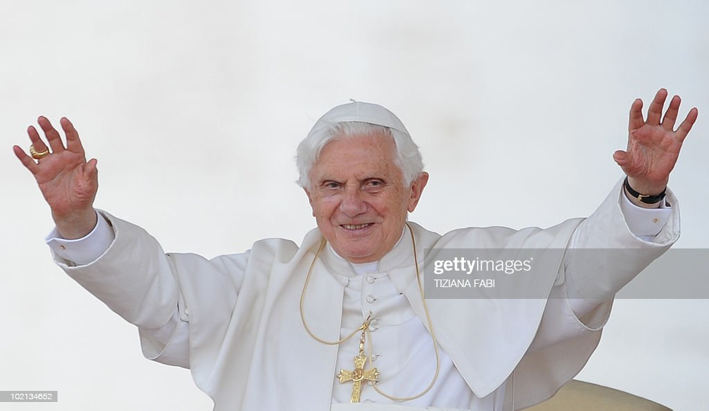 Pope Benedict XVI waves during his weekly general audience in Saint Peter's Square at the Vatican on June 16, 2010.