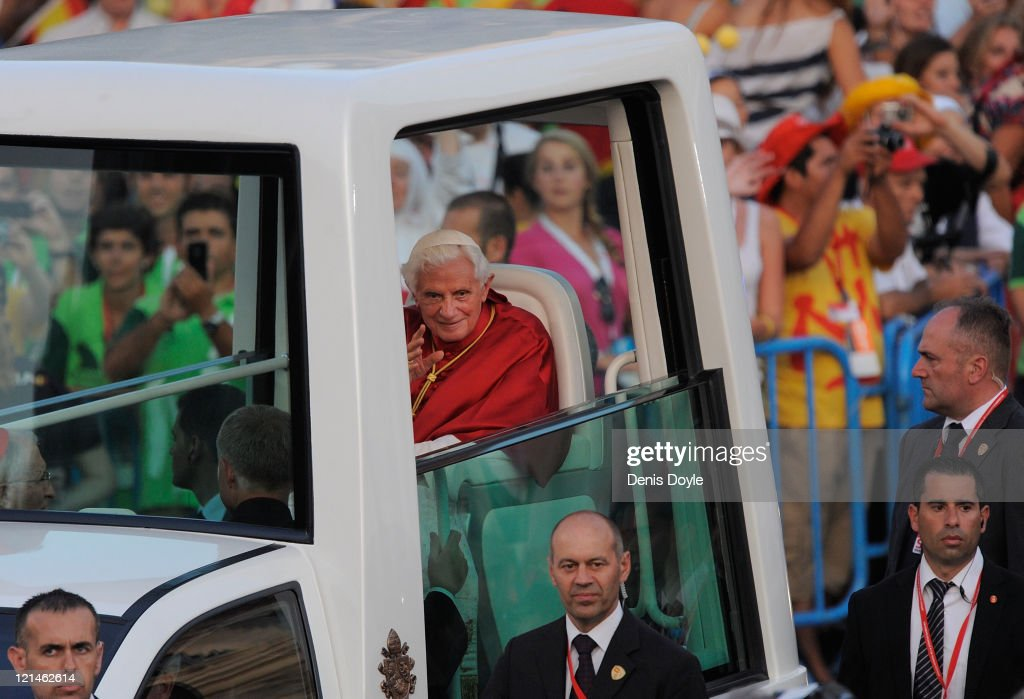 <a gi-track='captionPersonalityLinkClicked' href=/galleries/search?phrase=Pope+Benedict+XVI&family=editorial&specificpeople=201771 ng-click='$event.stopPropagation()'>Pope Benedict XVI</a> waves from the Popemobile at Cibeles square during a via crucis during World Youth Day 2011 celebrations on August 19, 2011 in Madrid, Spain. Initiated by Pope John Paul II in 1985, World Youth Day youth-oriented events for the celebration of the Catholic faith are held every three years in a different country; this time in Madrid from August 16th to 21st, with <a gi-track='captionPersonalityLinkClicked' href=/galleries/search?phrase=Pope+Benedict+XVI&family=editorial&specificpeople=201771 ng-click='$event.stopPropagation()'>Pope Benedict XVI</a> in attendance.
