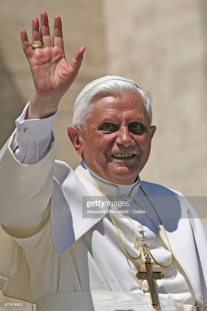 Pope Benedict XVI waves to Catholic faithfuls during his weekly general audience in Saint Peter's Square.