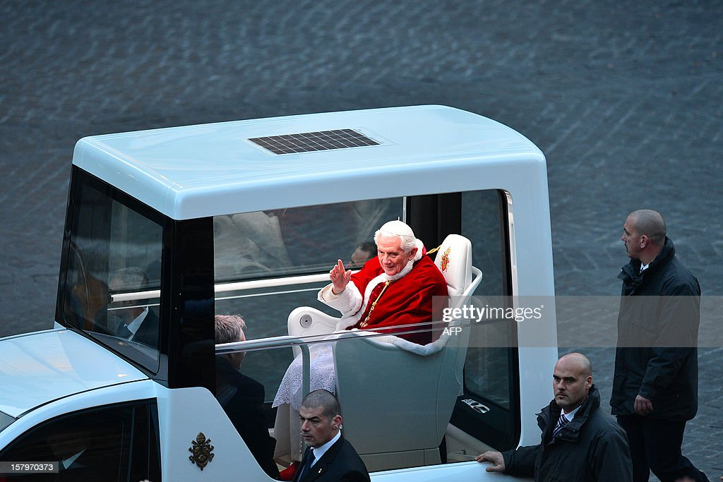 Pope Benedict XVI waves to faithful at Piazza di Spagna in his 'popemobile' before a prayer at the statue of virgin Mary during the annual feast of the Immaculate Conception at Piazza di Spagna (Spanish Steps) in Rome on December 8, 2012 on the day dedicated to virgin Mary.