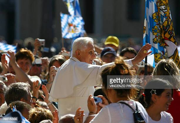 Pope Benedict XVI waves to pilgrims as he arrives in St Peter's square at the Vatican for his weekly general audience 05 September 2007 The pontiff...