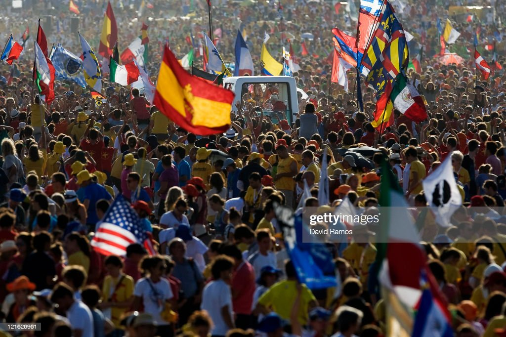 <a gi-track='captionPersonalityLinkClicked' href=/galleries/search?phrase=Pope+Benedict+XVI&family=editorial&specificpeople=201771 ng-click='$event.stopPropagation()'>Pope Benedict XVI</a> waves to the crowd at his arrival at the Cuatro Vientos Airport for the closing ceremony of the World Youth Day 2011 on August 21, 2011 in Madrid, Spain. Initiated by Pope John Paul II in 1985, World Youth Day youth-oriented events for the celebration of the Catholic faith are held every three years in a different country; this time in Madrid from August 16th to 21st, 2011.