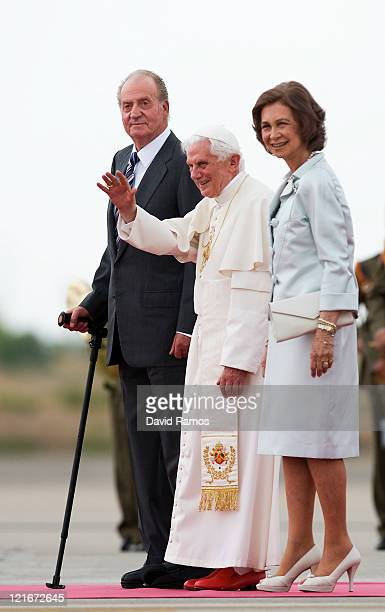 Pope Benedict XVI waves to the crowd surrounded by Queen Sofia and King Juan Carlos at the end of his visit to Spain for leading The World Youth Day...