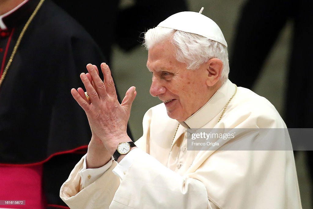 Pope Benedict XVI waves to the faithful as he arrives at the Paul VI Hall for his weekly audience on February 13, 2013 in Vatican City, Vatican. The Pontiff will hold his last weekly public audience on February 27 at St Peter's Square after announcing his resignation earlier this week.
