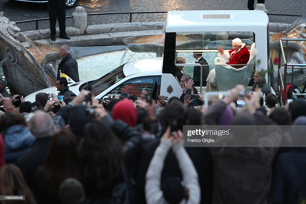 <a gi-track='captionPersonalityLinkClicked' href=/galleries/search?phrase=Pope+Benedict+XVI&family=editorial&specificpeople=201771 ng-click='$event.stopPropagation()'>Pope Benedict XVI</a> waves to the faithful as he arrives in his new Popemobile at the Spanish Steps for the celebration of the Immaculate Conception on December 8, 2012 in Rome, Italy. This papal tradition marks the beginning of the Christmas season as the Pope visits the monument and crowns the statue of Mary with a garland of flowers.