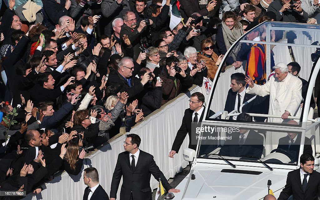 Pope Benedict XVI waves to the faithful as he arrives in St Peter's Square on February 27 2013 in Vatican City Vatican The Pontiff has attended his...