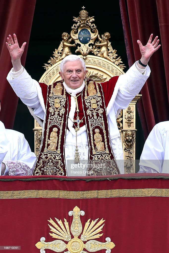 Pope Benedict XVI waves to the faithful as he delivers his Christmas Day message from the central balcony of St Peter's Basilica on December 25, 2012 in Vatican City, Vatican. The 'Urbi et Orbi' (to the city and to the world) is recognised as a Christmas tradition by Catholics with the Pope focusing this year on the conflict in Syria, calling for a political solution.