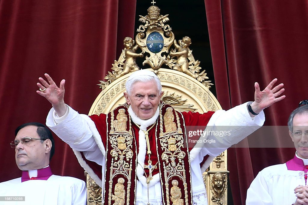 <a gi-track='captionPersonalityLinkClicked' href=/galleries/search?phrase=Pope+Benedict+XVI&family=editorial&specificpeople=201771 ng-click='$event.stopPropagation()'>Pope Benedict XVI</a> waves to the faithful as he delivers his Christmas Day message from the central balcony of St Peter's Basilica on December 25, 2012 in Vatican City, Vatican. The 'Urbi et Orbi' (to the city and to the world) is recognised as a Christmas tradition by Catholics with the Pope focusing this year on the conflict in Syria, calling for a political solution.