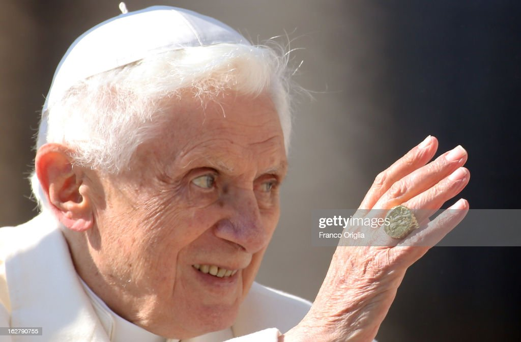 <a gi-track='captionPersonalityLinkClicked' href=/galleries/search?phrase=Pope+Benedict+XVI&family=editorial&specificpeople=201771 ng-click='$event.stopPropagation()'>Pope Benedict XVI</a> waves to the faithful as he leaves St Peter's Square at the end of his final general audience on February 27, 2013 in Vatican City, Vatican. The Pontiff attended his last weekly public audience before stepping down tomorrow. <a gi-track='captionPersonalityLinkClicked' href=/galleries/search?phrase=Pope+Benedict+XVI&family=editorial&specificpeople=201771 ng-click='$event.stopPropagation()'>Pope Benedict XVI</a> has been the leader of the Catholic Church for eight years and is the first Pope to retire since 1415. He cites ailing health as his reason for retirement and will spend the rest of his life in solitude away from public engagements.