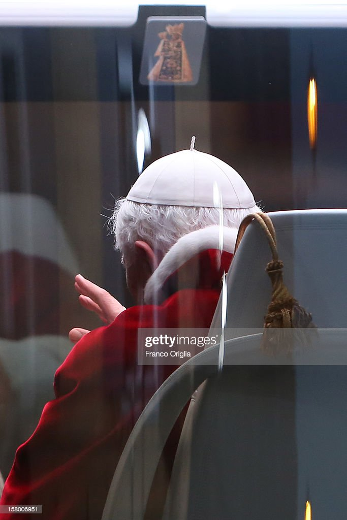 Pope Benedict XVI waves to the faithful as he lives in his new Popemobile the Spanish Steps at the end of the Immaculate Conception celebration on December 8, 2012 in Rome, Italy. This papal tradition marks the beginning of the Christmas season as the Pope visits the monument and crowns the statue of Mary with a garland of flowers.