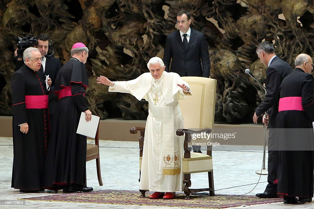 <a gi-track='captionPersonalityLinkClicked' href=/galleries/search?phrase=Pope+Benedict+XVI&family=editorial&specificpeople=201771 ng-click='$event.stopPropagation()'>Pope Benedict XVI</a> (C) waves to the faithful gathered at the Paul VI Hall during his weekly audience on January 9, 2013 in Vatican City, Vatican. The Pontiff gave the catechesis dedicated to the Year of Faith, during his regularly scheduled Wednesday general audience.