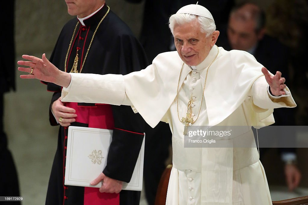 Pope Benedict XVI waves to the faithful gathered at the Paul VI Hall during his weekly audience on January 9, 2013 in Vatican City, Vatican. The Pontiff gave the catechesis dedicated to the Year of Faith, during his regularly scheduled Wednesday general audience.
