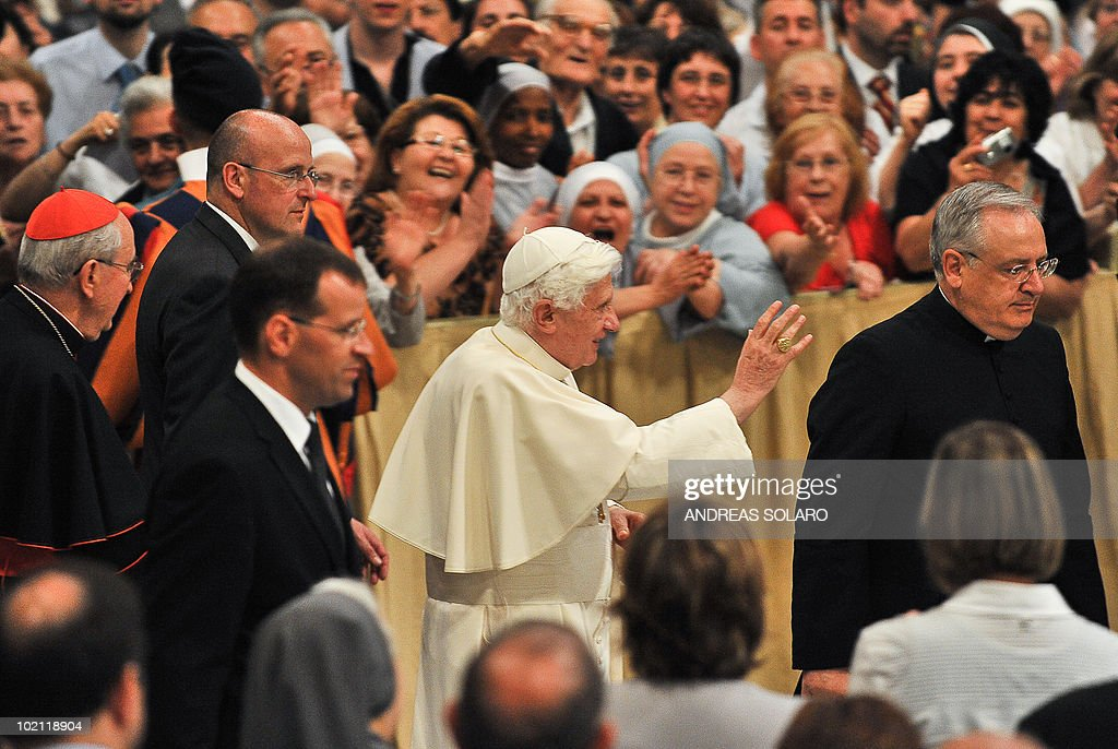 Pope Benedict XVI waves to the faithful gathered in Basilica San Giovanni in Laterano as he arrives for the opening of Roman diocesan convention on June 15, 2010 in Rome.