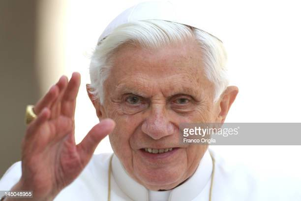 Pope Benedict XVI waves to the faithful gathered in St Peter's Square during his weekly audience on May 23 2012 in Vatican City Vatican Pontiff will...
