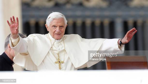 Pope Benedict XVI waves to the faithful gathered in St Peter's square during his weekly audience on October 3 2012 in Vatican City Vatican The trial...