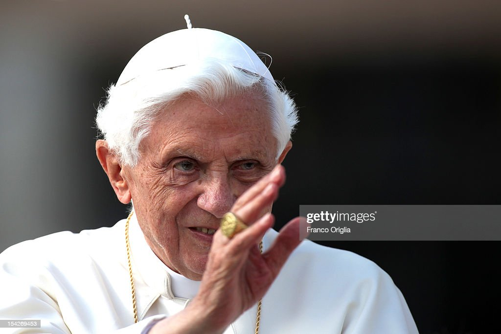 Pope Benedict XVI waves to the faithful gathered in St. Peter's square during his weekly audience on October 17, 2012 in Vatican City, Vatican. Pontiff has called for a 'Delegation to visit Damascus in the next few days, on behalf of God and all of us, to express our fraternal solidarity to the Syrian population and deliver a special offering from the Synod Fathers and the Holy See'. Members of the delegation include: the Archbishop of Kinshasa, Cardinal Laurent Mosengwo Pasinya; President of the Pontifical Council for Interreligious Dialogue, Cardinal Jean-Louis Tauran and the Archbishop of New York, Cardinal Timothy Dolan.
