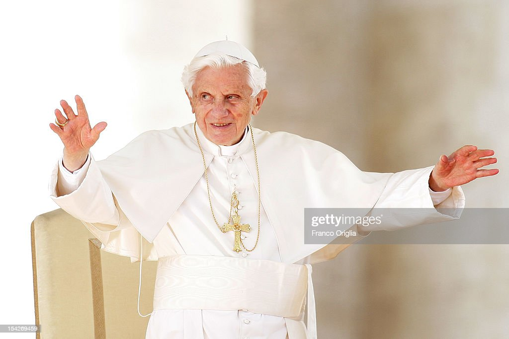 <a gi-track='captionPersonalityLinkClicked' href=/galleries/search?phrase=Pope+Benedict+XVI&family=editorial&specificpeople=201771 ng-click='$event.stopPropagation()'>Pope Benedict XVI</a> waves to the faithful gathered in St. Peter's square during his weekly audience on October 17, 2012 in Vatican City, Vatican. Pontiff has called for a 'Delegation to visit Damascus in the next few days, on behalf of God and all of us, to express our fraternal solidarity to the Syrian population and deliver a special offering from the Synod Fathers and the Holy See'. Members of the delegation include: the Archbishop of Kinshasa, Cardinal Laurent Mosengwo Pasinya; President of the Pontifical Council for Interreligious Dialogue, Cardinal Jean-Louis Tauran and the Archbishop of New York, Cardinal Timothy Dolan.