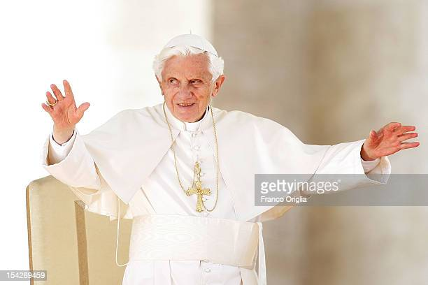 Pope Benedict XVI waves to the faithful gathered in St Peter's square during his weekly audience on October 17 2012 in Vatican City Vatican Pontiff...