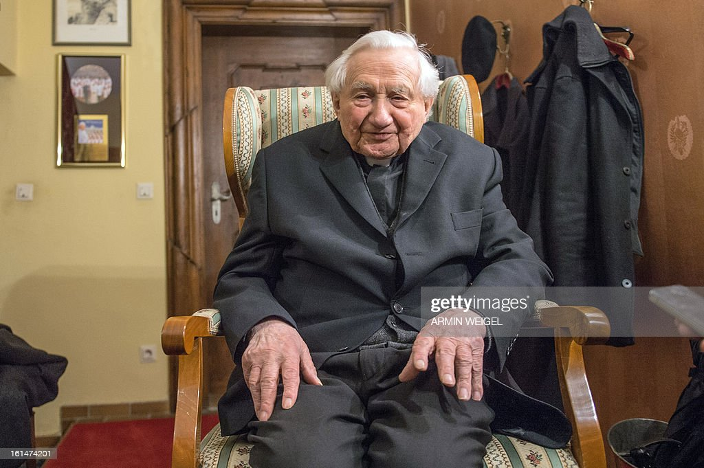 Pope Benedict XVI's brother Georg Ratzinger poses for a photo in his house in Regensburg, southern Germany, on February 11, 2013. The pope's brother said that the pontiff had been considering his resignation 'for a few months' and confirmed that the 85-year-old Benedict XVI was 'feeling his age.