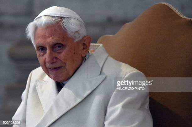 Pope Emeritus Benedict XVI arrives at St Peter's basilica before the opening of the 'Holy Door' by Pope Francis to mark the start of the Jubilee Year...