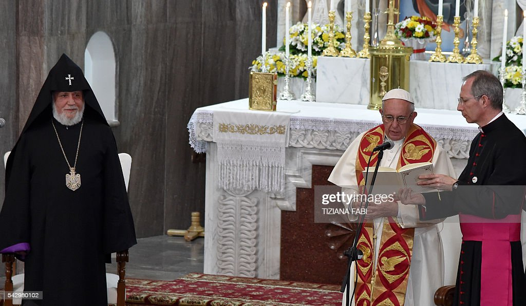 Pope Francis, accompanied by Catholicos of All Armenians Karekin II, visits the Catholic Cathedral of the Holy Martyrs in Armenia's second-largest city of Gyumri on June 25, 2016. / AFP / POOL / TIZIANA