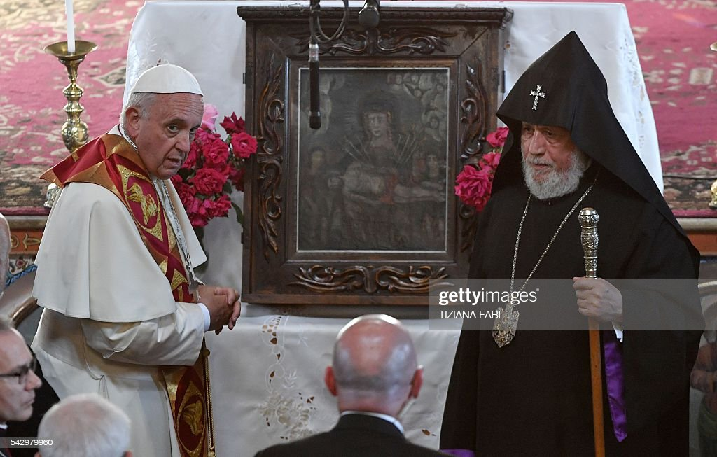 Pope Francis, accompanied with Catholicos of All Armenians Karekin II, visits the Armenian Apostolic Cathedral of the Seven Wounds in Armenia's second-largest city of Gyumri on June 25, 2016. / AFP / POOL / Tiziana FABI