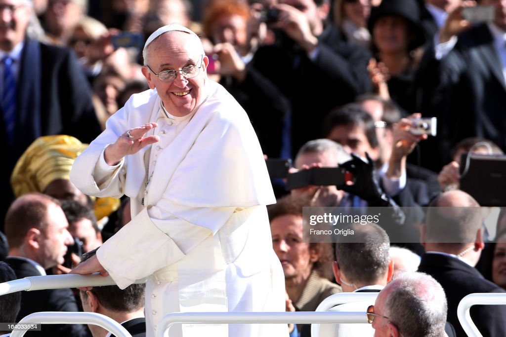 <a gi-track='captionPersonalityLinkClicked' href=/galleries/search?phrase=Pope+Francis&family=editorial&specificpeople=2499404 ng-click='$event.stopPropagation()'>Pope Francis</a> acknowledges the crowd of faithful as he arrives in St. Peter's Square for his Inauguration Mass on March 19, 2013 in Vatican City, Vatican. The inauguration of <a gi-track='captionPersonalityLinkClicked' href=/galleries/search?phrase=Pope+Francis&family=editorial&specificpeople=2499404 ng-click='$event.stopPropagation()'>Pope Francis</a> is being held in front of an expected crowd of up to one million pilgrims and faithful who have crowded into St Peter's Square and the surrounding streets to see the former Cardinal of Buenos Aires officially take up his position. <a gi-track='captionPersonalityLinkClicked' href=/galleries/search?phrase=Pope+Francis&family=editorial&specificpeople=2499404 ng-click='$event.stopPropagation()'>Pope Francis</a>' inauguration takes place in front his cardinals, spiritual leaders as well as heads of states from around the world and he will now lead an estimated 1.3 billion Catholics.