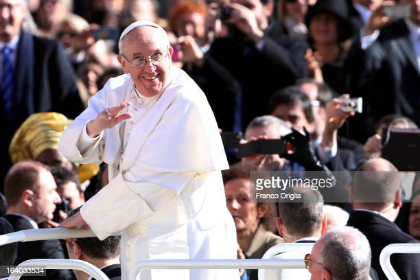 Pope Francis acknowledges the crowd of faithful as he arrives in St Peter's Square for his Inauguration Mass on March 19 2013 in Vatican City Vatican...