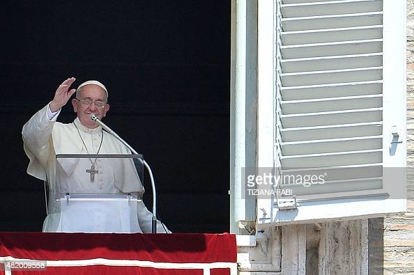 Pope Francis addresses the crowd from the window of the Apostolic Palace overlooking Saint Peter's square during the Angelus prayer at the Vatican on...
