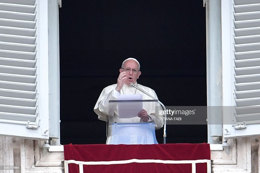 Pope Francis addresses the crowd from the window of the apostolic palace overlooking St.Peter's square during his Sunday Angelus prayer on May 1, 2016 at the Vatican.