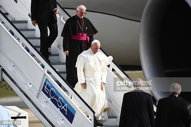 Pope Francis alights from the plane upon arrival in Santiago de Cuba on September 21 2015 Santiago the last stop on Pope Francis's Cuban tour is...