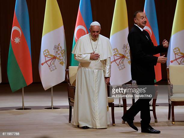 Pope Francis and Azerbaijan's President Ilham Aliyev arrive to the Aliyev congress center for a meeting with the authorities in Baku Azerbaijan on...