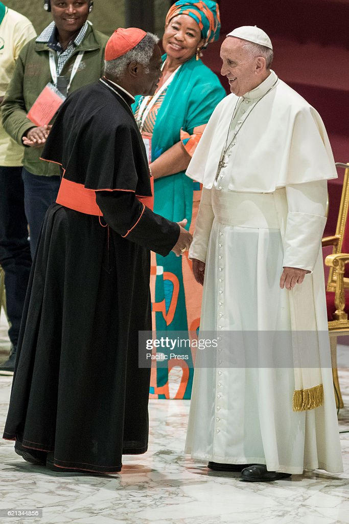 Pope Francis and Cardinal Peter Kodwo Appiah Turkson (L) attend an audience with representatives of Third World Meeting of Popular Movements in Paul VI hall in Vatican City, Vatican. The Meeting brings together organizations of people on the margins of society, including the poor, the unemployed and those who have lost their agricultural land.