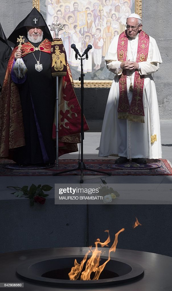 Pope Francis and Catholicos of All Armenians Karekin II attend a ceremony in commemoration of Armenians killed by Ottoman forces during World War I at the Tsitsernakaberd Genocide Memorial in Yerevan on June 25, 2016. / AFP / POOL / Maurizio BRAMBATTI