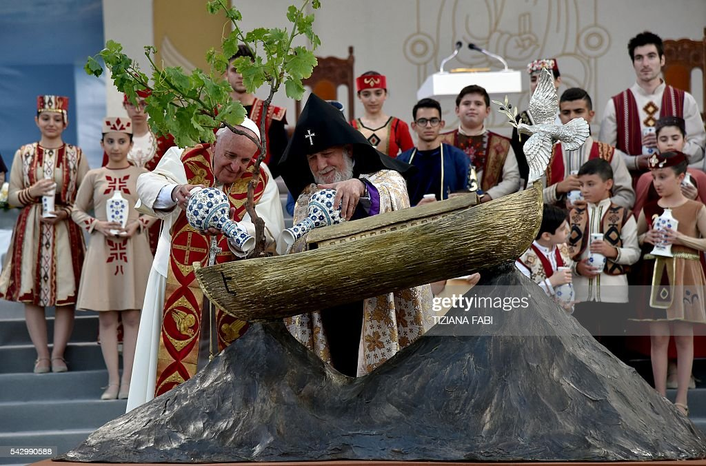 Pope Francis and Catholicos of All Armenians Karekin II water a tree planted in a Noah's Ark sculpture during an ecumenical meeting and a prayer for peace in Yerevan's Republic Square on June 25, 2016. / AFP / TIZIANA